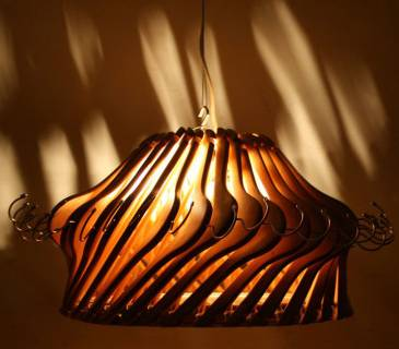 A 'Hangolier'  contemporary lampshade made from vintage wooden coat  hangers