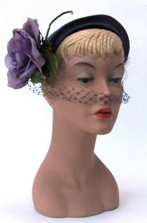 Purple straw hat with purple veil and rose, labelled 'Elsie', c. 1953