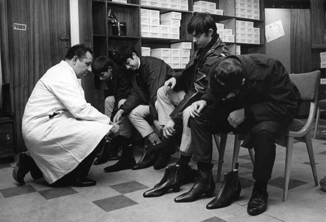 The Beatles trying on boots at Anello & Davide, Charing Cross, London, c. 1963