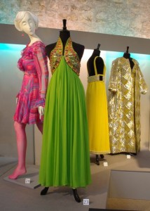 Left to right: pink silk chiffon print dress, unlabelled, spring 1968; sequined green silk dress by Oscar de la Renta for Jane Derby, c. 1968; Yellow silk backless dress by Heinz Riva, Rome, c. 1966; gold and silver lame evening gown and coat by Richard Tam for Sara Fredericks, spring 1968.