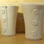Three button handle-less mugs