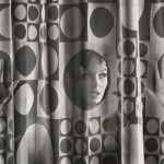 Unidentified image of model looking through shower curtain, c. late 1960s