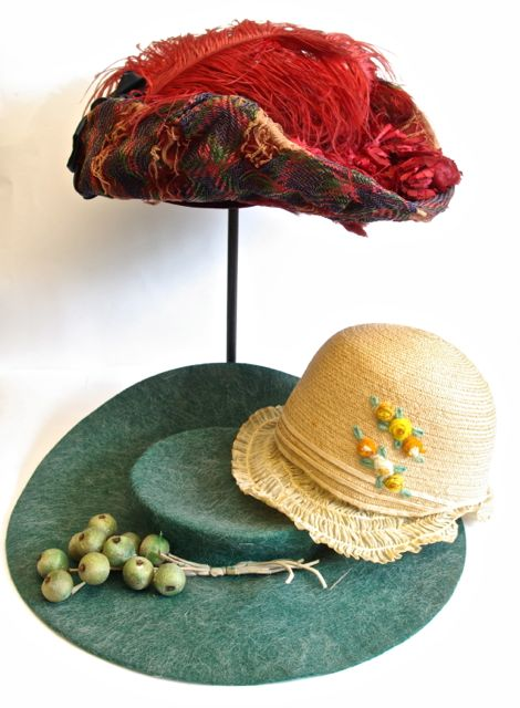 Girl's embroidered straw cloche from Canandaigua antique store; Green felt hat trimmed with grapes and multi-coloured straw hat trimmed with red flowers and feathers,  both early Edwardian, from the Sturbridge sale