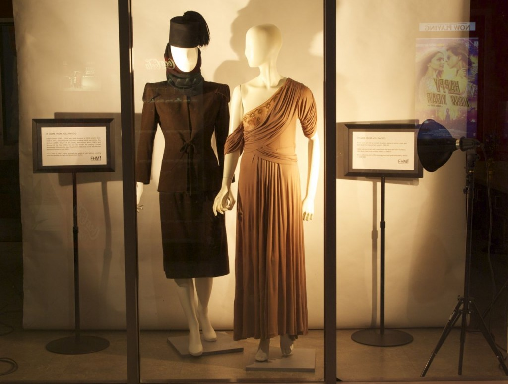 Adrian suit and hat, mid 1940s, and beige silk jersey and chiffon evening gown, c. late 1940s, all by Adrian, on display now until November 7 at Landmark Cinema in Kitchener.