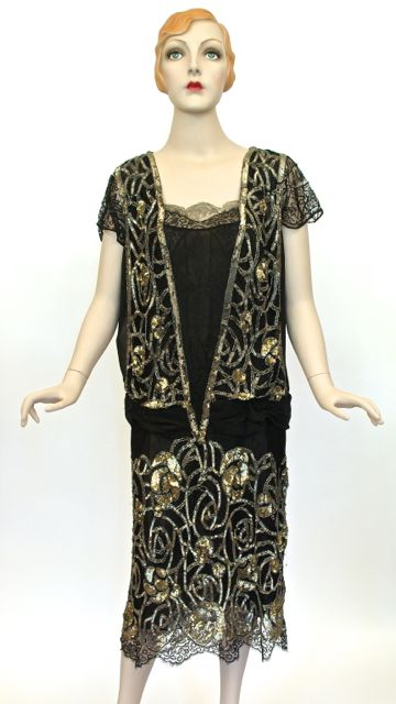 Silver sequin, metallic and black silk lace evening dress, labelled 'Made in France'. Donated by Jennifer Earle and originally owned and worn by her mother in the late 1920s.