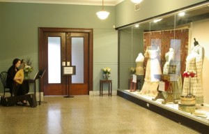 The 1950s counter was replaced with a glass curtain wall case for delicate artifacts, creating a separate gallery