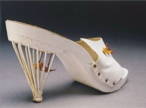 White leather and painted wood mule with wire cage heel with glass birds on swing. Labelled Creazioni Moriarty Anacapa, Italian, c. 1957