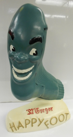 Latex counter model of the maniacal smiling sock - typically found in chain stores that carried Happy Foot McGregor socks in the 1950s